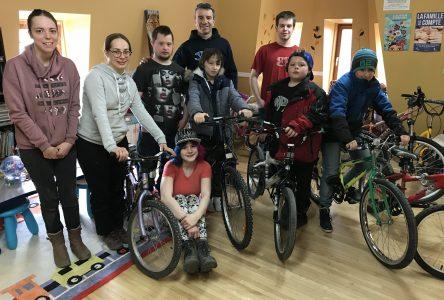 Free Wheeling donates 14 bikes to local youth