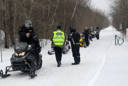 Police watching snowmobile trails