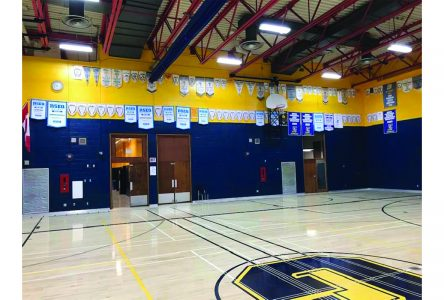 Alexander Galt raises nearly 500 sports banners in newly renovated gym