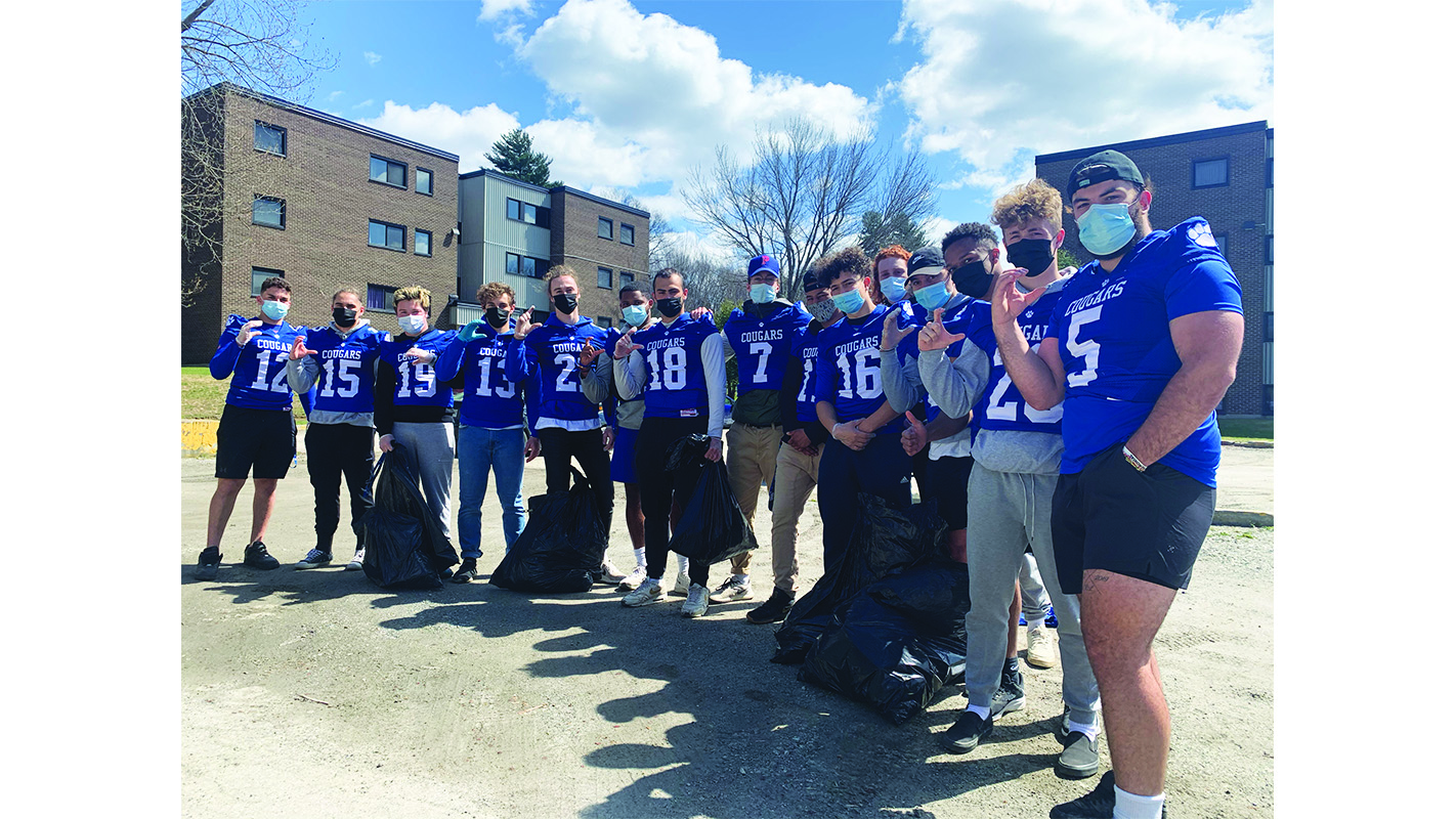 Cougars football players participate in cleaning up Lennoxville
